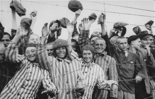 Dachau-Survivors-cheer-Americans-29Apr1945.jpg